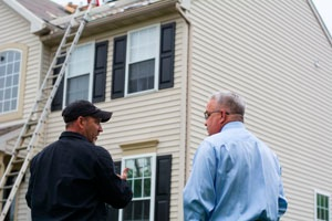 homeowner with a roofer