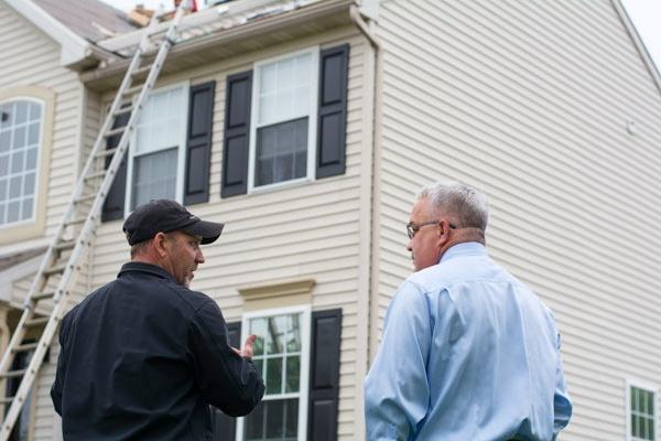 Roofer_Talking_Homeowner2.jpg