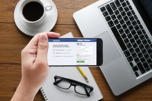 Bangkok, Thailand - Mar 10, 2015: Man on a ipad  Browsing Facebo